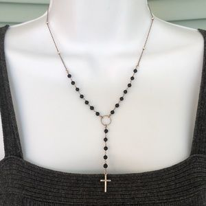 Rosary style silver and black onyx beaded necklace